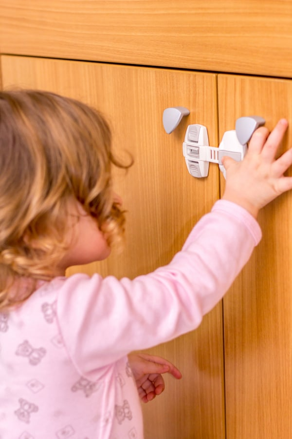 Child-proofed cabinets and toilets