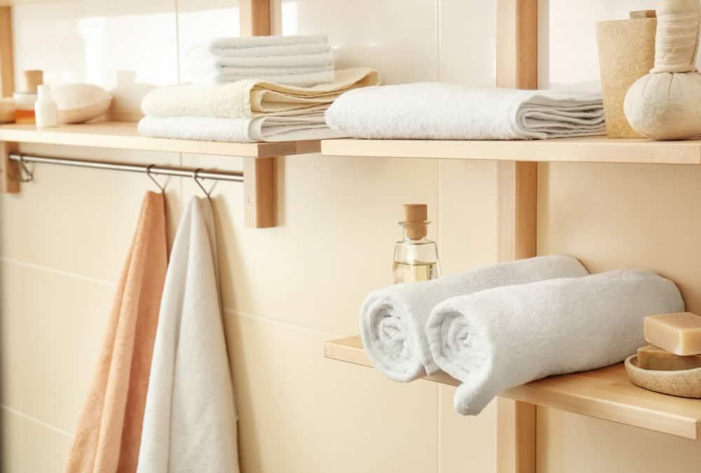 Put up a shelf with a towel rack