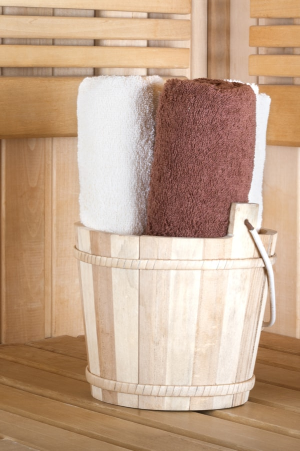 Store towels in a bathroom bucket