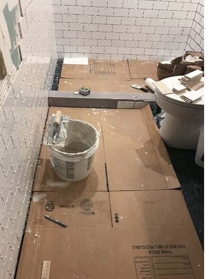 Adding the grout in between the tiles