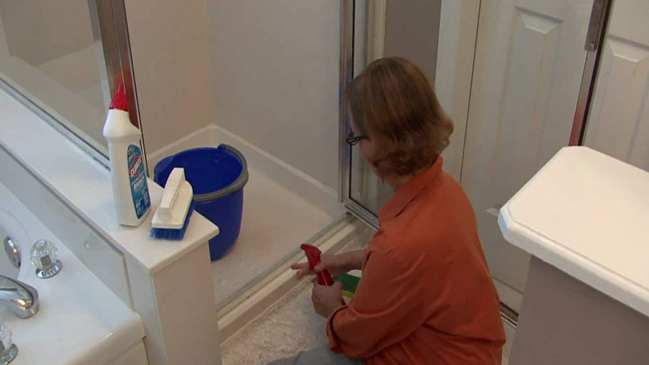 Clean shower door tracks with a commercial cleaner