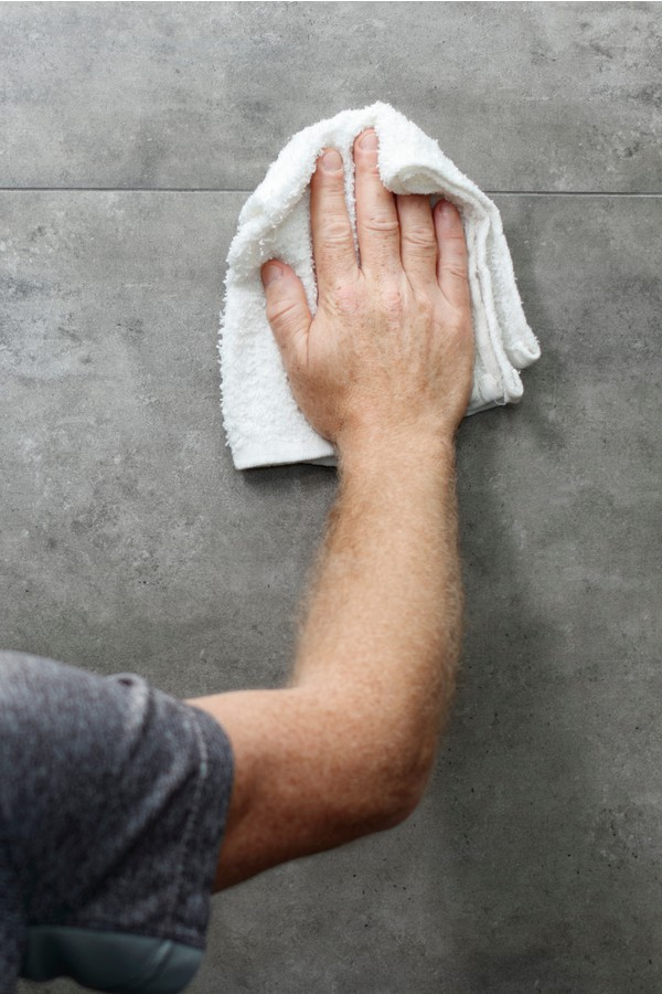 Pre-clean the wall with a moist sponge