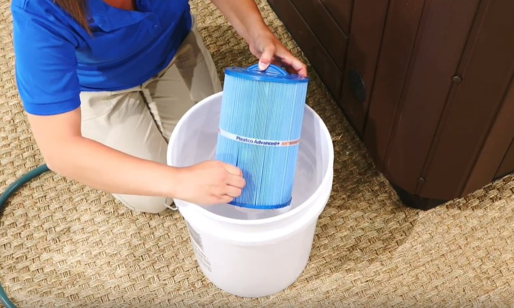 Remove larger debris by hand