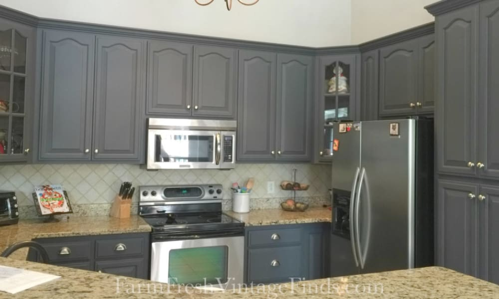 Black kitchen cabinet with milky paint finish