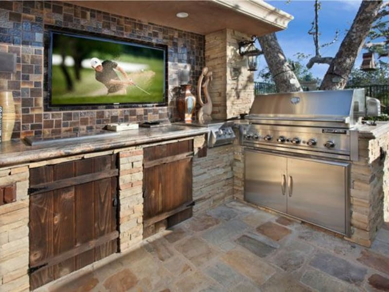DIY wood and stone outdoor kitchen
