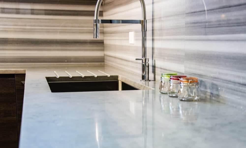 Full granite backsplash and a countertop