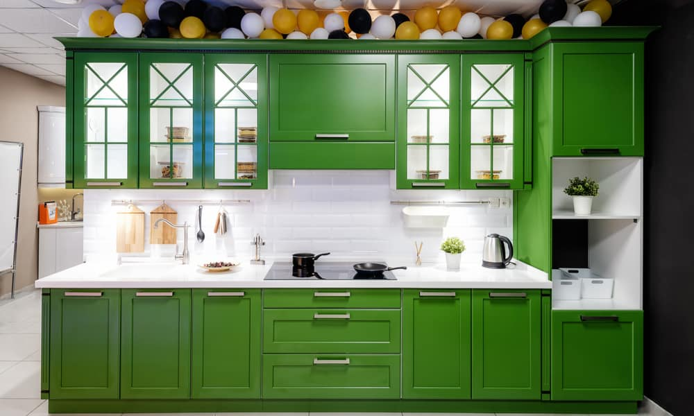 Green kitchen with an acrylic countertop