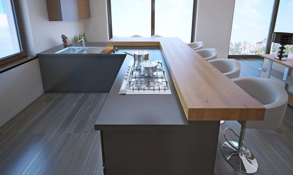 L-shaped kitchen with a light wood countertop