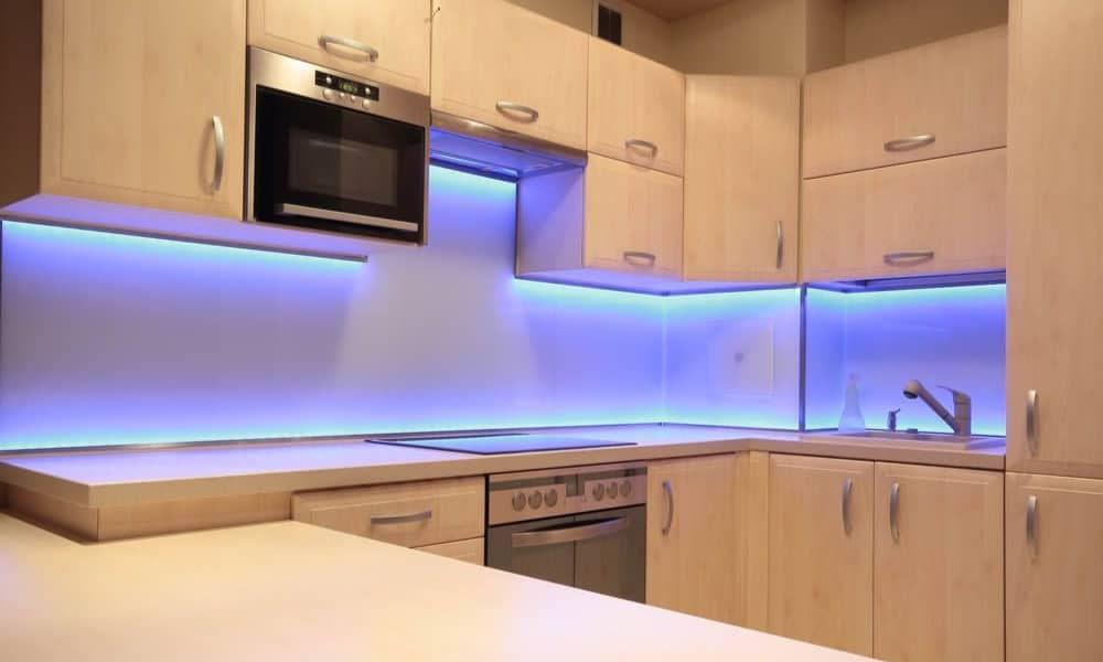Neon lights under a kitchen cabinet