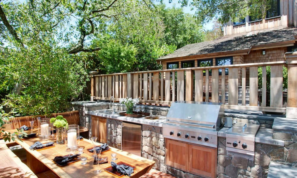 Outdoor kitchen with a dining space
