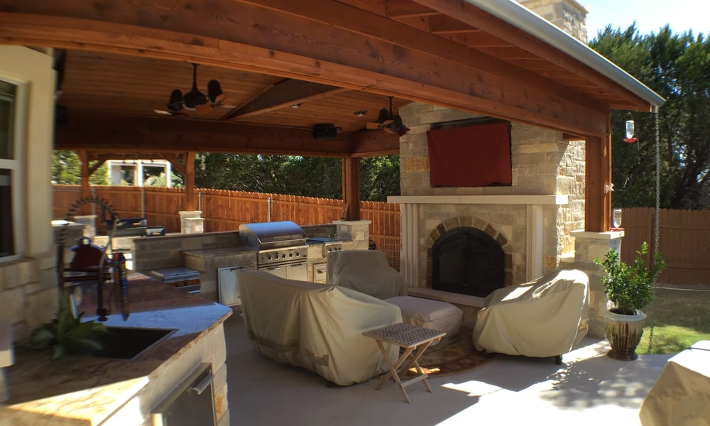 Outdoor kitchen with a fireplace 1