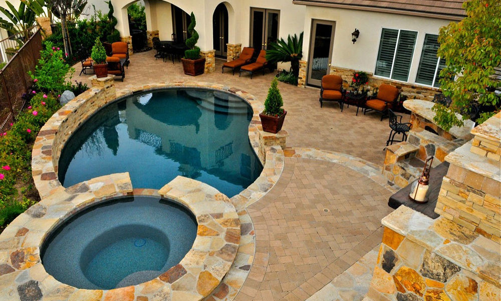 Outdoor kitchen with a pool bar
