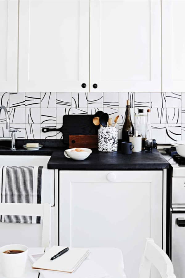 Painted tiles backsplash