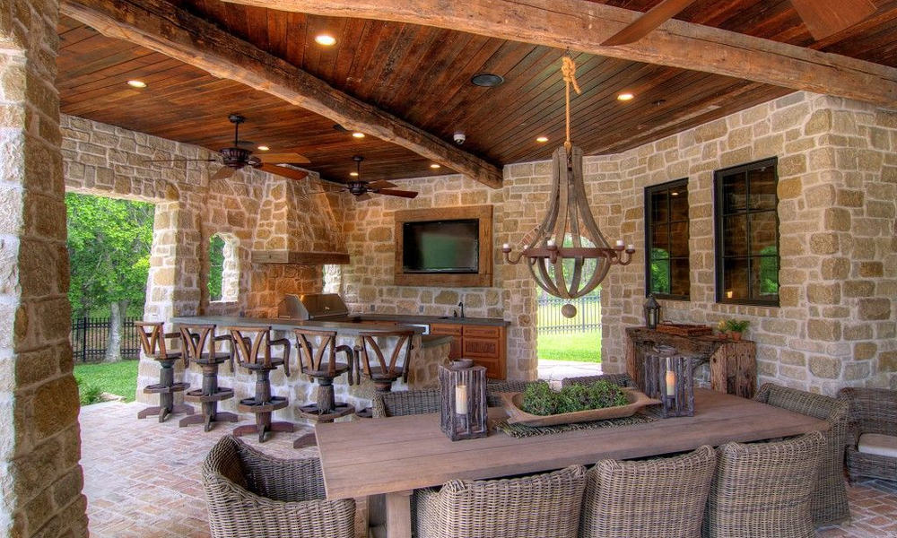 Rustic outdoor kitchen and living room