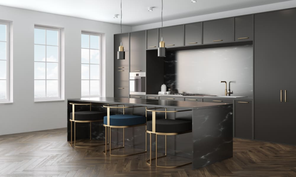 Spacious kitchen with a black marble countertop