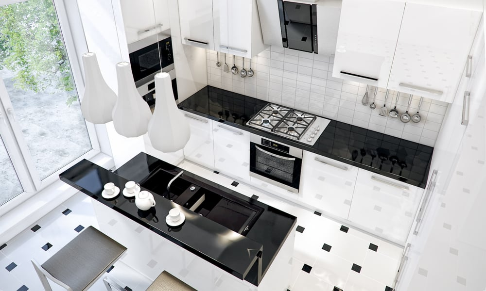 White kitchen with a glossy black countertop
