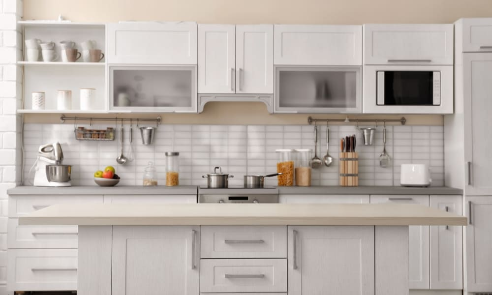 White, long kitchen cabinet with a beige countertop