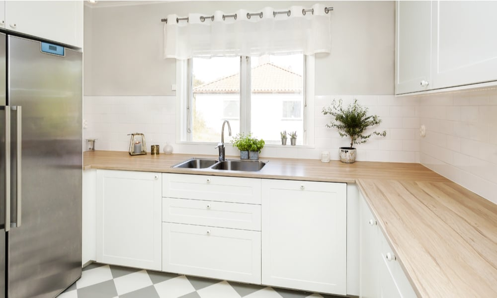White wooden kitchen with Harlequin floor