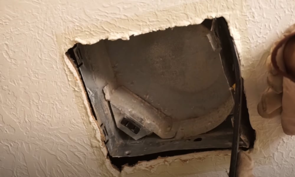 Disconnect the pipe for the vent and remove the fan housing
