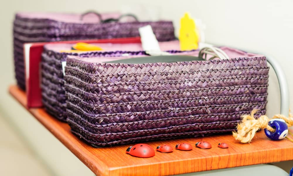 Purple Baskets on the Top of a Cupboard