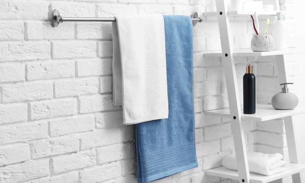 Hang up bathmats and damp towels