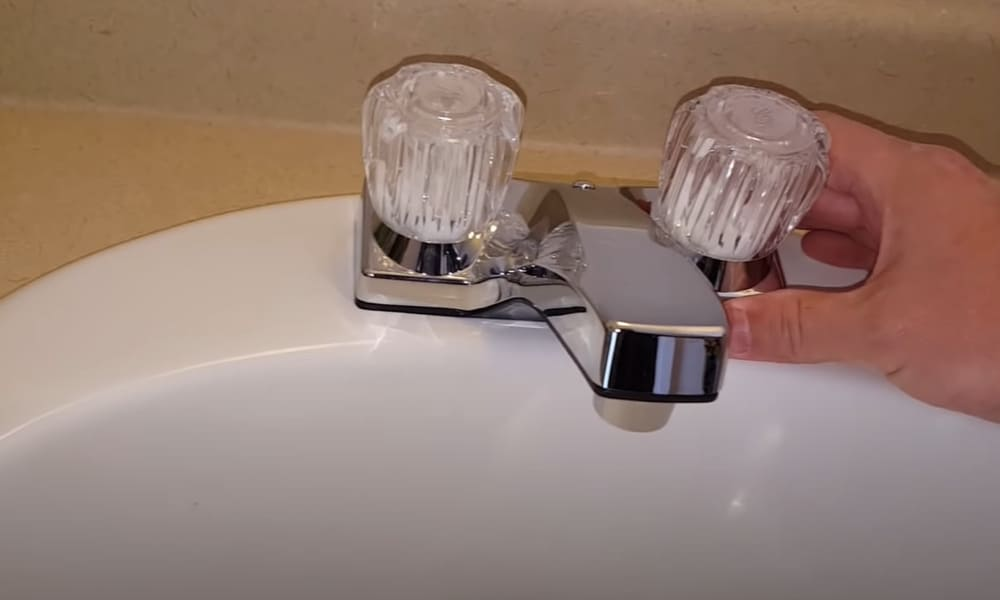 Put the new faucet in place