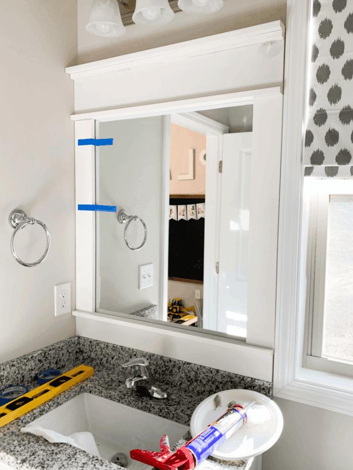 DIY How to Frame A Builder-Grade Bathroom Mirror